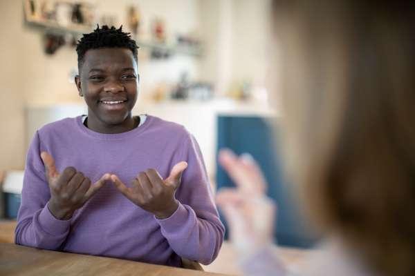 teen using sign language
